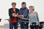 Andrew Williams, centre, former North Shore Mayor who started the project cuts the ribbon at the First Splash opening of the Sir Owen Glenn National Aquatic Centre, AUT Millennium, North Shore, Auckland, New Zealand, Saturday, August 01, 2015. Copyright photo: David Rowland / www.photosport.nz