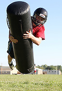 Alden Betzer, 17, senior, flies through the air during a tackling drill on the first day of football practice at Central City High School in Central City on Wednesday afternoon, August 3, 2011.