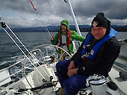 Rain squall rolling in.  Nelson Rolens eyes the numbers while Dennis Hollingshead tests weather helm on J/46 Riva.  2014 Swiftsure International Yacht Race, Victoria, British Columbia, Canada.  Olympus Tough TG-1.