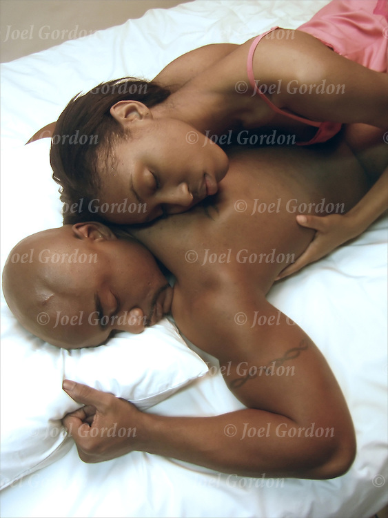 African American couple in bed engaging in erotic sexual behavior exploring each partners anatomy The sexual anatomy plays an important role in sexual pleasure and intimacy.