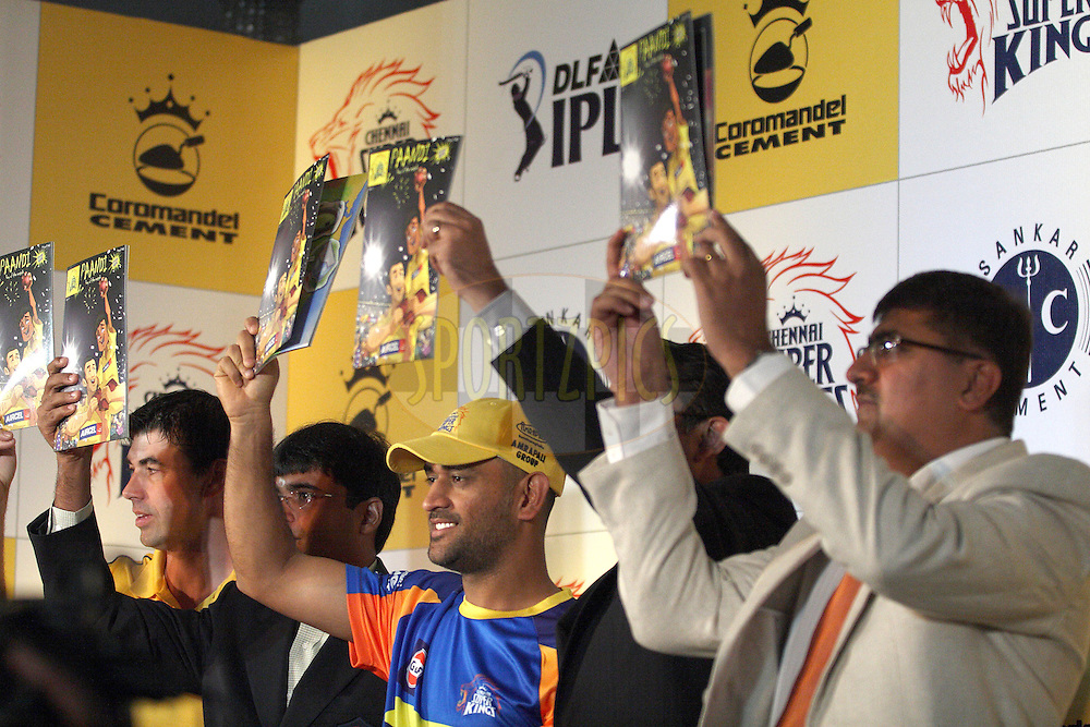CHENNAI: Chennai Super Kings captain Mahendra Singh Dhoni (left) and coach Stephan Fleming and team management hold up the new cartoon comic at the opening launch of the Chennai Super Kings on April 6 2011. Photo by: Vino John