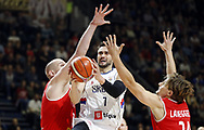 BELGRADE, Nov. 25, 2017  Serbia's Ivan Paunic (C) tries to lay up a shot against Austria's Moritz Lanegger (R) during the FIBA Basketball World Cup qualifying match between Serbia and Austria in Belgrade, Serbia on Nov. 24. 2017. Serbia won 85-64. (Credit Image: © Predrag Milosavljevic/Xinhua via ZUMA Wire)