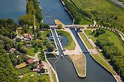 Nederland, Limburg, Gemeente Maasgouw, 27-05-2013; sluis Panheel, kanaal Wessem-Nederweert.<br /> De sluis is voorzien van spaarbekkens (om bij het schutten water te besparen bij lage waterstanden van de Maas).<br /> Shipping lock Panheel, canal Wessem-Nederweert. The lock is equipped with reservoirs to save water at low water levels of the river Meuse.<br /> luchtfoto (toeslag op standaardtarieven);<br /> aerial photo (additional fee required);<br /> copyright foto/photo Siebe Swart.