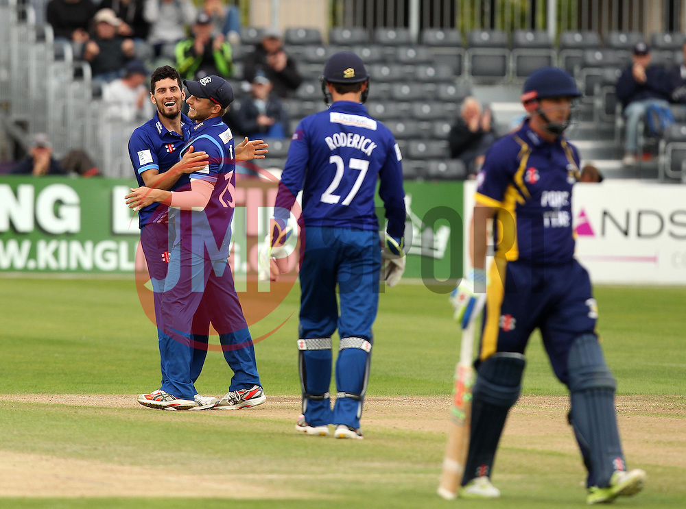 Gloucestershire's Benny Howell celebrates the wicket of Durham's Phil Mustard with Gloucestershire's Chris Dent who took the catch - Mandatory by-line: Robbie Stephenson/JMP - 07966386802 - 04/08/2015 - SPORT - CRICKET - Bristol,England - County Ground - Gloucestershire v Durham - Royal London One-Day Cup