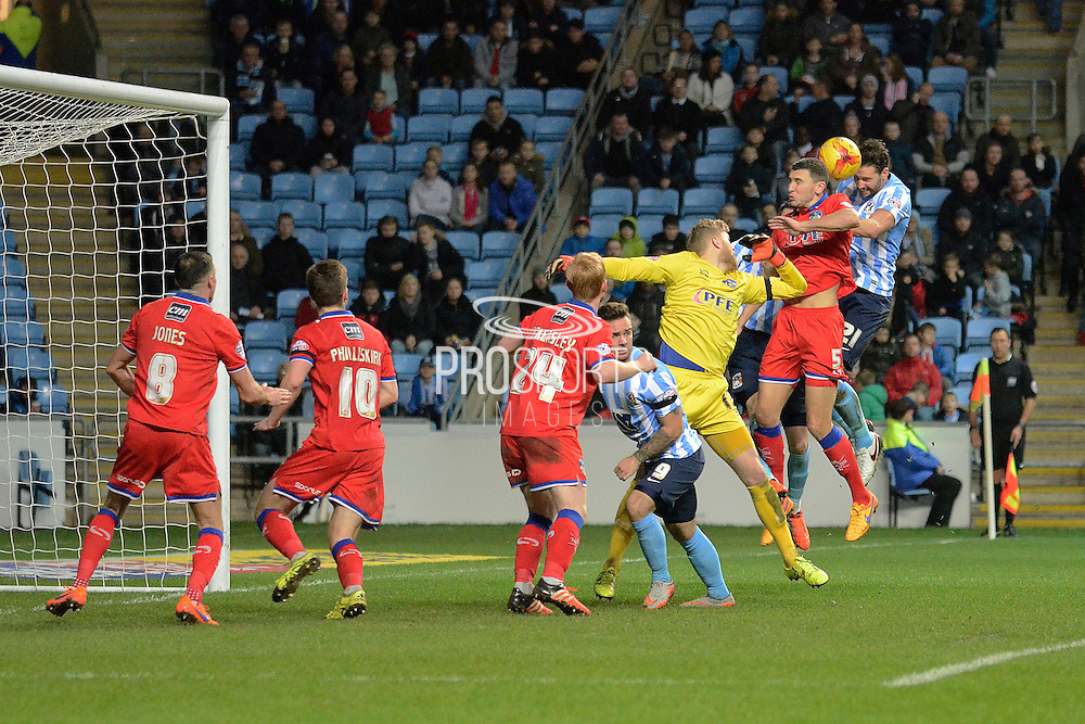 Coventry City defender Aaron Martin heads home the opening goal during the Sky Bet League 1 match between Coventry City and Oldham Athletic at the Ricoh Arena, Coventry, England on 19 December 2015. Photo by Alan Franklin.