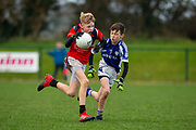 24/11/2018, Cumann na mBunScol Primary School Finals at St Lomans Park, Trim. <br /> Boys Division 2 Football Final<br /> Scoil Naomh Barra, Wilkinstown vs Kildalkey NS<br /> Aidan Rennie (Scoil Naomh Barra, Wilkinstown) & Conor McNally (Kildalkey NS)<br /> David Mullen / www.cyberimages.net<br /> ISO: 2500; Shutter: 1/1250; Aperture: 4<br /> File Size: 2.9MB<br /> Print Size: 8.6 x 5.8 inches