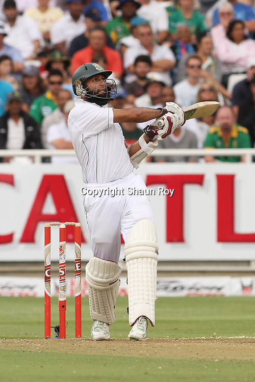CAPE TOWN, SOUTH AFRICA - 2 January 2011, Hushim Amla of South Africa miss times his pull shot to be caught on the boundary during day 1 of the 3rd Castle Test between South Africa and India held at Sahara Park Newlands Stadium in Cape Town, South Africa on the 2 January 2011 .Photo by: Shaun Roy