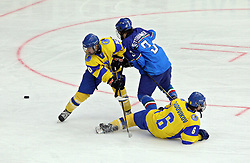 April 18, 2018 - Kyiv, Ukraine - Forwards Kyrylo Lanin and Stanislav Sadovikov (L to R, yellow kit) are seen in action with defenceman Lukas Klettenhammer (C) of Italy during the 2018 IIHF Ice Hockey U18 World Championship Division I Group B Round Robin match at the Palace of Sports in Kyiv, capital of Ukraine, April 18, 2018. Ukrinform. (Credit Image: © Danil Shamkin/Ukrinform via ZUMA Wire)
