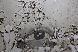 remains of a painted eye on a  prison wall