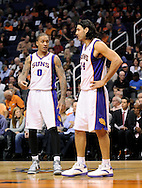 Dec. 09, 2012; Phoenix, AZ, USA; Phoenix Suns forward Michael Beasley (0) and forward Luis Scola (14) talks on the court during the game against the Orlando Magic in the first half at US Airways Center. Mandatory Credit: Jennifer Stewart-USA TODAY Sports