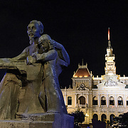 "At left is a statue of ""Uncle Ho,"" while in the background is Ho Chi Minh City Hall. Ho Chi Minh City Hall was built in the early 20th Century by the French colonial government as Saigon's city hall. It's also known as Ho Chi Minh City People's Committee Head office, in French as Hôtel de Ville de Saigon, and in Vietnamese as Tr? s? ?y ban Nhân dân Thành ph? H? Chí Minh."