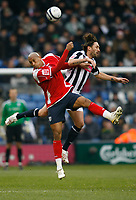 Photo: Steve Bond/Sportsbeat Images.<br /> West Bromwich Albion v Charlton Athletic. Coca Cola Championship. 15/12/2007. Madjid Bougherra (L) aand Jonathan Greening (R) clash in the air