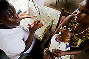 Nurse Eugenia Beatson meets with Ramatu Zango talk about her 7-month-old daughter Sekinata Sakande (7.7 kg) during a counseling session at the Osu Maternity Home in Accra, Ghana on Tuesday June 16, 2009.