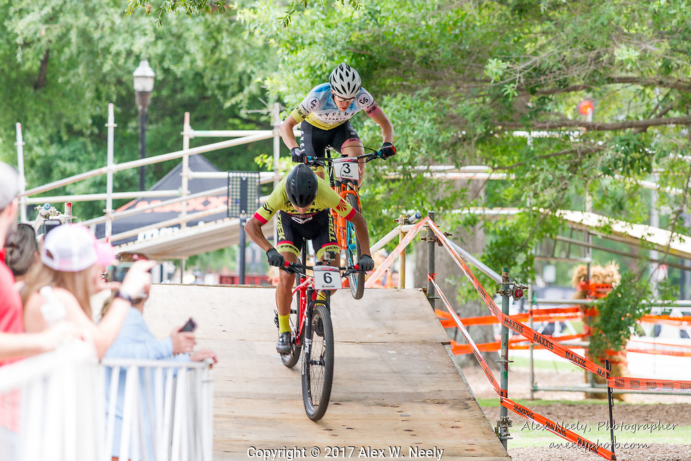 Seth Kemp (#3 USA) is in the air over the last bump as he tries to chase down Daniel Castillo Noyola (#6 MEX) during the 2nd heat of the 1/2 finals at the  UCI Mountain Bike Eliminator World Cup held in  Columbus, GA, USA on June 4, 2017.