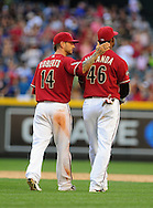 May 1 2011; Phoenix, AZ, USA; Arizona Diamondbacks third basemen Ryan Roberts (14) congratulates first basemen Juan Miranda (46) after defeating the Cubs 4-3 at Chase Field. Mandatory Credit: Jennifer Stewart-US PRESSWIRE.