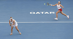 DOHA, Feb. 19, 2018  Gabriela Dabrowski (L) of Canada and Jelena Ostapenko of Latvia compete during the double's final match against Andreja Klepac of Slovenia and Maria Jose Martinez Sanchez of Spain at the 2018 WTA Qatar Open in Doha, Qatar, on Feb. 18, 2018. Gabriela Dabrowski and Jelena Ostapenko won 2-0 to claim the title. (Credit Image: © Nikku/Xinhua via ZUMA Wire)