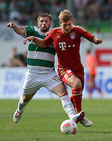 Fussball 1. Bundesliga :  Saison   2012/2013   1. Spieltag  25.08.2012 SpVgg Greuther Fuerth - FC Bayern Muenchen Toni Kroos (re, FC Bayern Muenchen) gegen Sebastian Tyrala (Greuther Fuerth)
