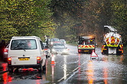 © Licensed to London News Pictures. 15/11/2015. Windermere UK. Flooded roads are causing traffic chaos around Windermere after last nights heavy rainfall, more rain is expected & the Environment agency have issued alerts for the area. Photo credit: Andrew McCaren/LNP