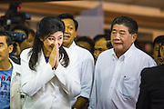 03 MARCH 2013 - BANGKOK, THAILAND: . YINGLUCK SHINAWATRA, the Thai Prime Minister, greets Pheu Thai supporters as she arrives at the Pheu Thai press conference to announce that Pongsapat Pongchareon had lost the Bangkok governor's election. Pongsapat Pongchareon, running on the Pheu Thai ticket, lost the Bangkok's Governor's race to MR Sukhumbhand Paribatra, the incumbent running on the Democrat ticket. Sukhumbhand won the race after scoring a record number of votes, more than 1.2 million to Pongsapat's 1 million. The results were seen as an upset even though Sukhumbhand was the incumbent because all of the pre-election polls and the exit polls conducted on election day showed Patsapong winning.    PHOTO BY JACK KURTZ