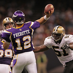2008 October, 06: Minnesota Vikings quarterback Gus Frerotte (12) throws as New Orleans Saints linebacker Jonathan Vilma (51) comes in for the hit during a week five regular season game between the Minnesota Vikings and the New Orleans Saints for Monday Night Football at the Louisiana Superdome in New Orleans, LA.