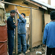 Roma in the illegal camp of Zitkovac in the outskirts of Mitrovice.  The camp lies next to the rubbish dump of the town. Roma are unwanted by both the Serbian and the Kosovan side of the town. They survive with some support from humanitarian organisations and by sellin things they found in the skips.