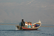 Myanmar Shan state Inle lake tourists on a tour of the lake in a traditional local fishing boat