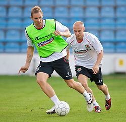 PODGORICA, MONTENEGRO - Tuesday, August 11, 2009: Wales' Jack Collison and David Cotterill during a training session at the Gradski Stadion ahead of the international friendly match against Montenegro. (Photo by David Rawcliffe/Propaganda)