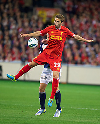 MELBOURNE, AUSTRALIA - Wednesday, July 24, 2013: Liverpool's Fabio Borini in action against Melbourne Victory during a preseason friendly match at the Melbourne Cricket Ground. (Pic by David Rawcliffe/Propaganda)