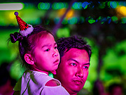 "23 DECEMBER 2018 - CHANTABURI, THAILAND: A girl and her father watch the Christmas show at the Cathedral of the Immaculate Conception's Christmas Fair in Chantaburi. Cathedral of the Immaculate Conception is holding its annual Christmas festival, this year called ""Sweet Christmas @ Chantaburi 2018"". The Cathedral is the largest Catholic church in Thailand and was founded more than 300 years ago by Vietnamese Catholics who settled in Thailand, then Siam.   PHOTO BY JACK KURTZ"