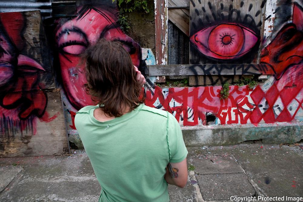 Negus looking over his grafitti art.