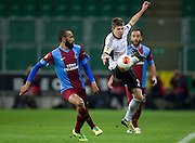 (R) Legia's Jakub Kosecki fights for the ball with (L) Trabzonspor's Jose Bosingwa during the UEFA Europa League Group J football match between Legia Warsaw and Trabzonspor AS at Pepsi Arena Stadium in Warsaw on November 07, 2013.<br /> <br /> Poland, Warsaw, November 07, 2013<br /> <br /> Picture also available in RAW (NEF) or TIFF format on special request.<br /> <br /> For editorial use only. Any commercial or promotional use requires permission.<br /> <br /> Mandatory credit:<br /> Photo by &copy; Adam Nurkiewicz / Mediasport