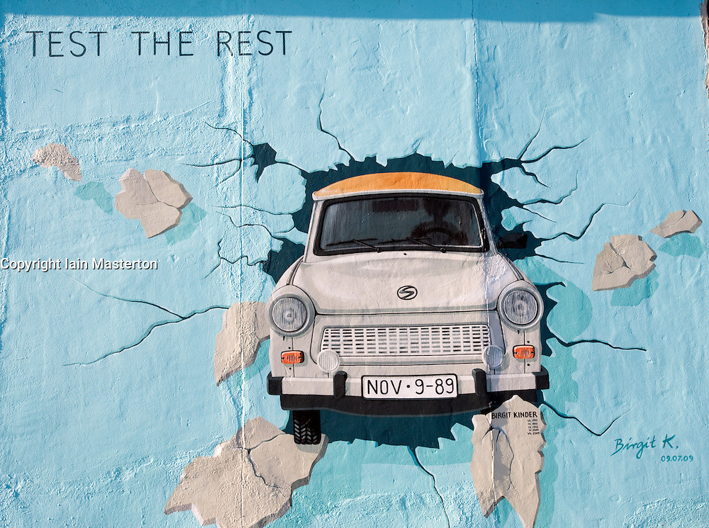 Painting of the iconic East German Trabant car on the Berlin Wall at the East Side Gallery in Kreuzberg Berlin