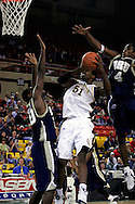 25 November 2005: Jamil Lott (51) attempts a shot for Marquette over ORU junior forward Caleb Green (30) with ORU senior Larry Owens (4) coming in from behind for the block in the Marquette University 73-70 victory over Oral Roberts University at the Great Alaska Shootout in Anchorage, Alaska