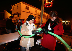 Katie Fondrisi, left, tutors Miss Jeffersontown, Holly Gilbert, in the art of balloon animal design.  (By Jonathan Palmer, Special to The Courier-Journal) December 6, 2008