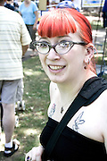 Woman age 26 with red hair enjoying the festival. Svenskarnas Dag Swedish Heritage Day Minnehaha Park Minneapolis Minnesota USA