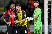 Bournemouth forward Callum Wilson and Burton Albion defender Kieran Wallace during the EFL Cup match between Burton Albion and Bournemouth at the Pirelli Stadium, Burton upon Trent, England on 25 September 2019.