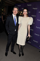 GARY OLDMAN and ALEXANDRA EDENBOROUGH at the Asprey BAFTA Party held at Asprey, 167 New Bond Street, London on 11th February 2012.