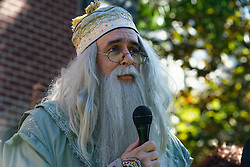 An actor in his roll as Professor Albus Percival Wulfric Brian Dumbledore speaks to the crowds gathered at the opening ceremony of the sixht annual Harry Potter Fstival, i Chestnut Hill, on Saturday. (Bastiaan Slabbers/for PhillyVoice)