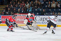 KELOWNA, CANADA - OCTOBER 4:  Jordon Cooke #30 of the Kelowna Rockets makes a save against the Portland Winterhawks  at the Kelowna Rockets on October 4, 2013 at Prospera Place in Kelowna, British Columbia, Canada (Photo by Marissa Baecker/Shoot the Breeze) *** Local Caption ***