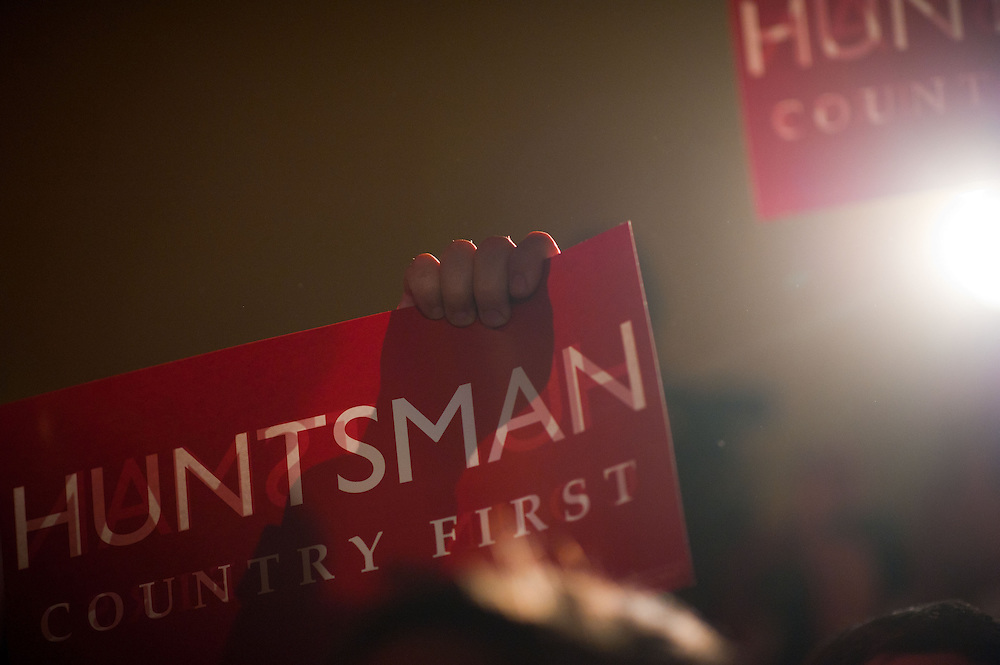 GOP Presidential candidate John Huntsman supporters holds signs at his election night campaign event at The Black Brimmer Bar on Tuesday, Jan. 10, 2012 in Manchester, NH. (Photo by Jay Westcott/Politico)