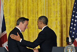 59640505  . U.S. President Barack Obama (R) shakes hand with British Prime Minister David Cameron as they leave a joint press conference following their talks at the White House in Washington D.C. on May 13, 2013. Photo by: imago / i-Images. UK ONLY