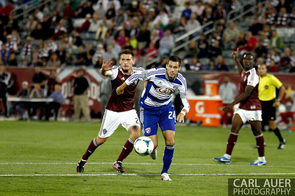 June 1st, 2013 - FC Dallas defender Matt Hedges (24) gets the ball past Colorado Rapids midfielder Shane O'Neill (27) in second half action of the MLS match between FC Dallas and the Colorado Rapids at Dick's Sporting Goods Park in Commerce City, CO