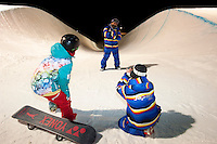 Team trainer Katsu Shimazki strikes a pose for coach Naoki Wataya while rider Ryo Aono encourages from the side.  They are part of an international group of national snowboard teams who gave up the mountains to come to the Otsego Club in mid-Michigan.