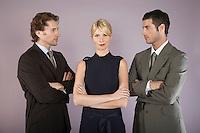 Businesswoman surrounded by businessmen portrait