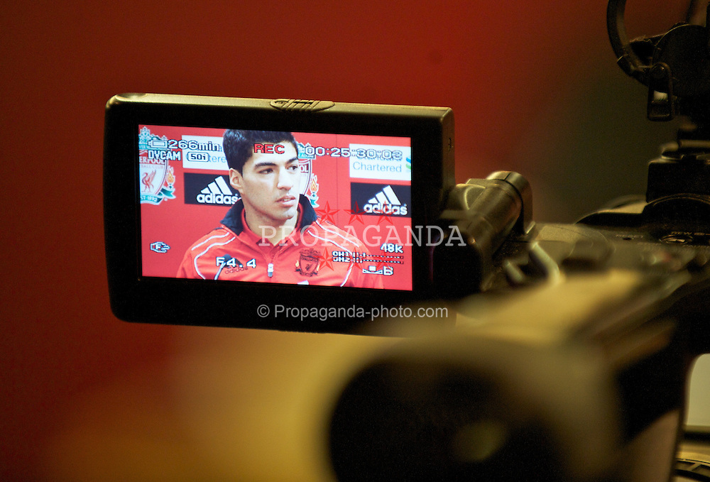 LIVERPOOL, ENGLAND - Thursday, February 3, 2011: Liverpool's new siginging Luis Suarez during a photo-call at Anfield. Suarez signed from Ajax for £22.8m. (Photo by David Rawcliffe/Propaganda)