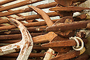 A pile of rusty anchors stacked on the dock at Sakonnet Point.