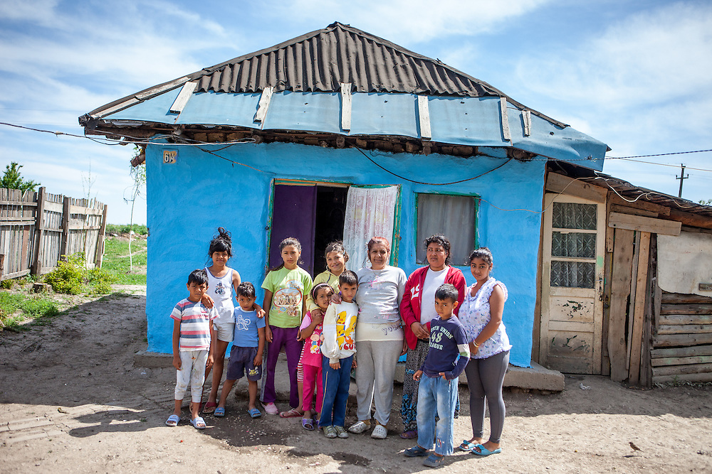 The Nae family in front of their house n the Roma area of Frumusani. In Frumusani, the Roma Education Fund—supported by the World Bank, Open Society Foundations, the European Union, and other donors—is working to remove the barriers local Roma children face to complete their primary school education.