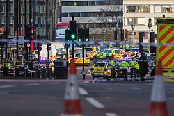 London, March 22nd 2017. Emergency services vehicles on Westminster Bridge and outside the houses of parliament, following what is suspected to be a terrorism incident where a car mowed down several pedestrians, killing one and critically injuring others, before its driver entered the grounds of Parliament, stabbing a police officer who subsequently died, and being shot himself by police.