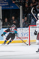 KELOWNA, CANADA - NOVEMBER 6: Kris Schmidli #16 of the Kelowna Rockets skates behind the net and celebrates a goal against the Red Deer Rebels on NOVEMBER 6, 2013 at Prospera Place in Kelowna, British Columbia, Canada.   (Photo by Marissa Baecker/Shoot the Breeze)  ***  Local Caption  ***