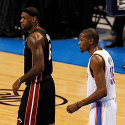 Jun 14, 2012; Oklahoma City, OK, USA;  Miami Heat small forward LeBron James (6) and Oklahoma City Thunder small forward Kevin Durant (35) on the court during the first quarter of game two in the 2012 NBA Finals at Chesapeake Energy Arena. Mandatory Credit: Derick E. Hingle-US PRESSWIRE